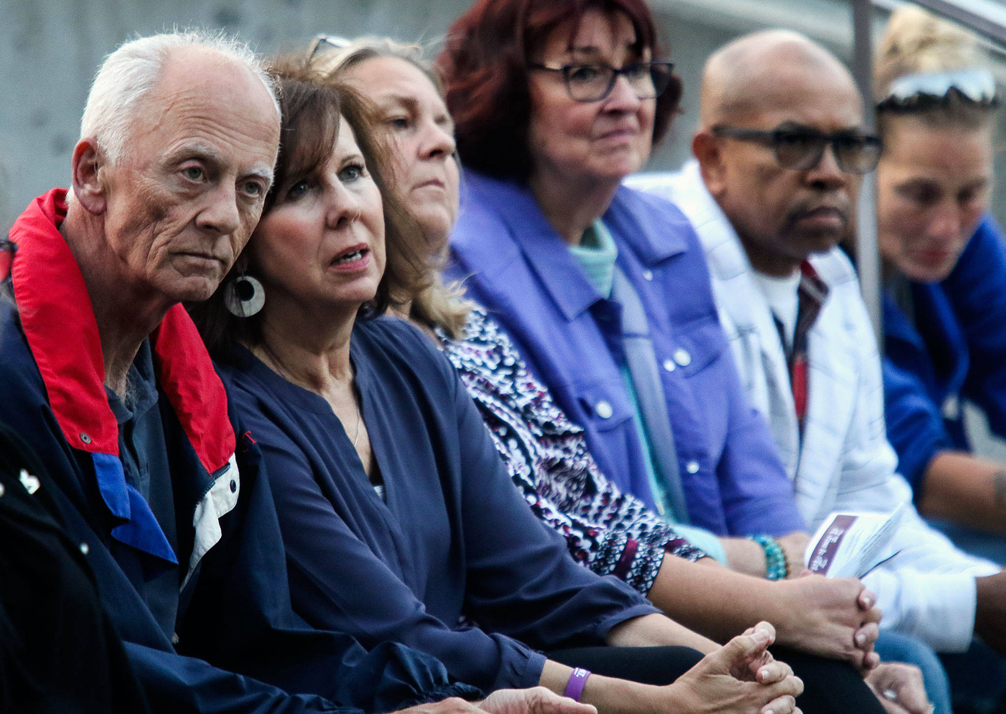 "Mike and Debbie Warfield (left), who lost their 24-year-old son Spencer to a heroin overdose, listen with others to speakers at ""A Night to Remember, A Time to Act."" The event, Thursday night at the courhouse plaza, drew attention to the opioid crisis. (Dan Bates / The Herald)"
