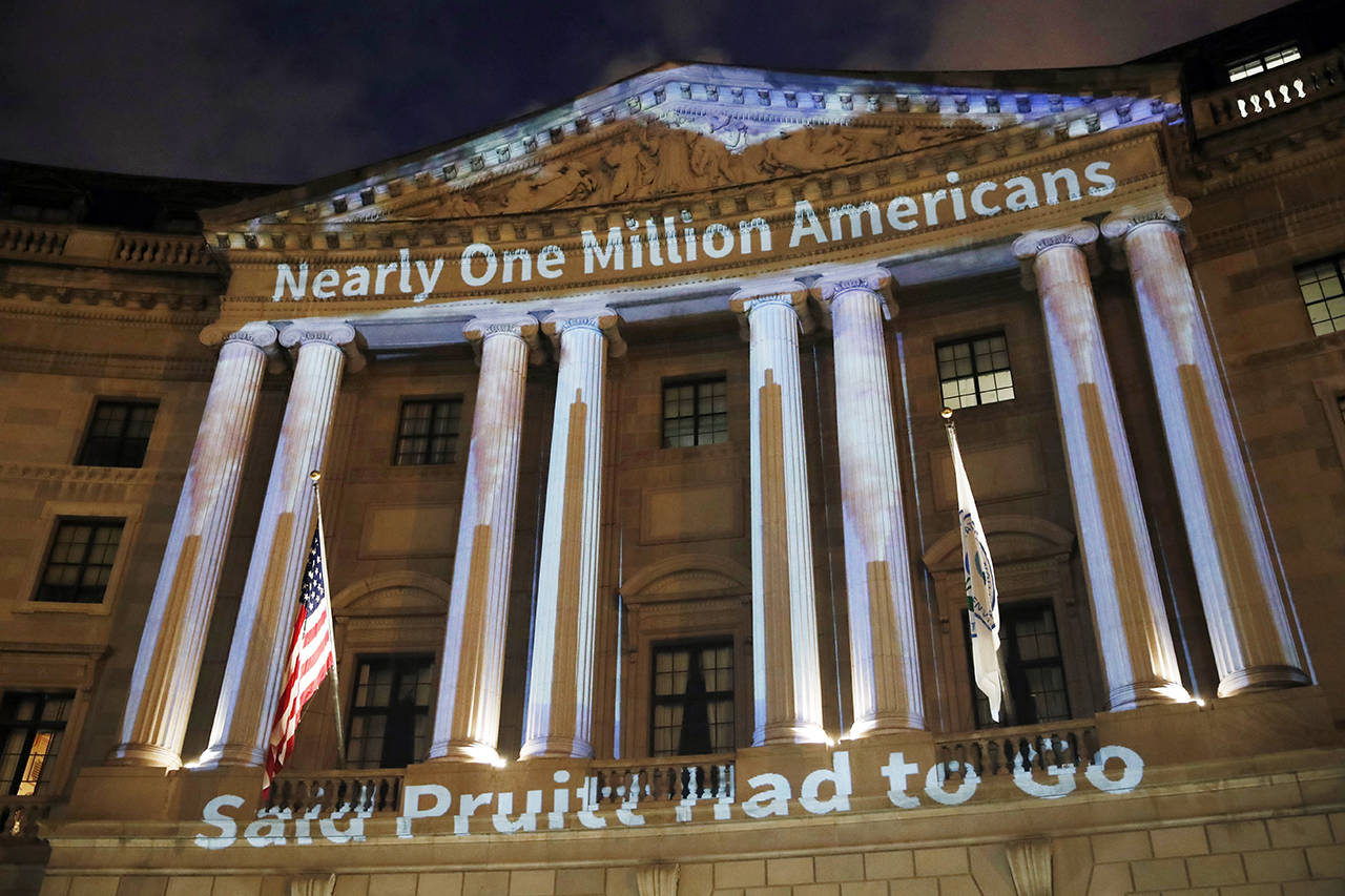 A message is projected on the Environmental Protection Agency on July 23 in Washington. (AP Photo/Alex Brandon)