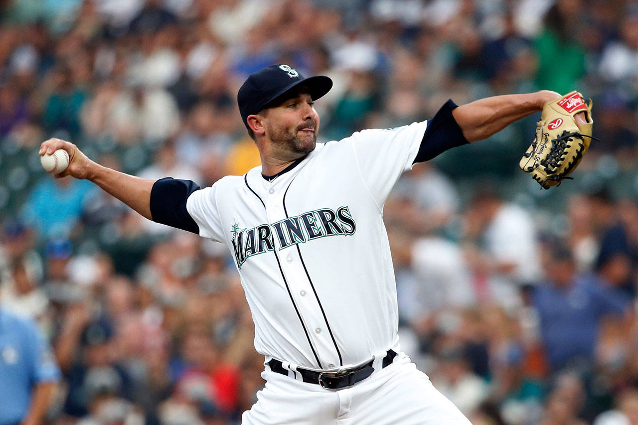Seattle's Nick Vincent throws a pitch in the first inning of Tuesday's game at Safeco Field. (AP Photo/Jennifer Buchanan)