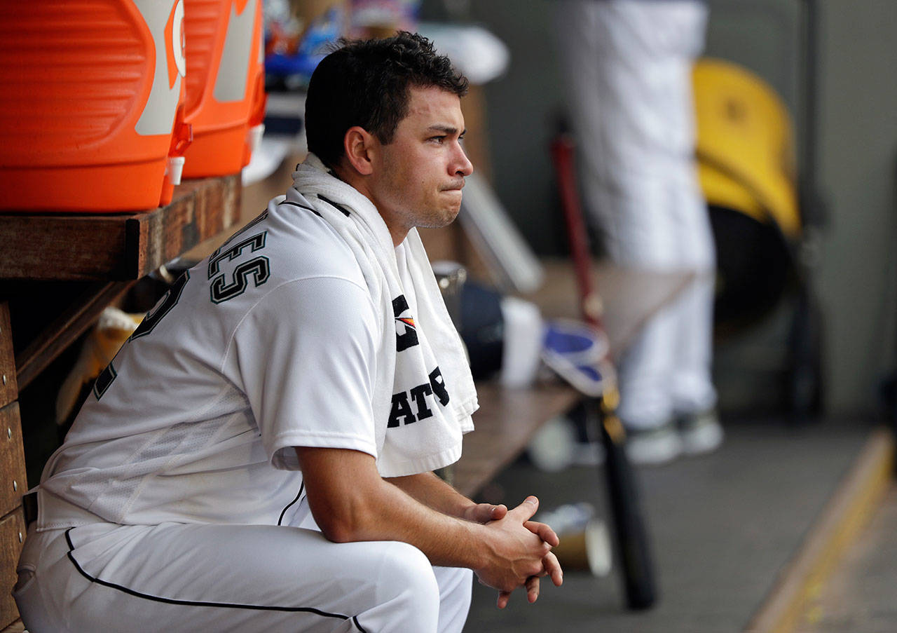 Mariners starting pitcher Marco Gonzales looks out from the dugout after being relieved against the Astros in the fourth inning of a game on Aug. 22, 2018, in Seattle. (AP Photo/Elaine Thompson)