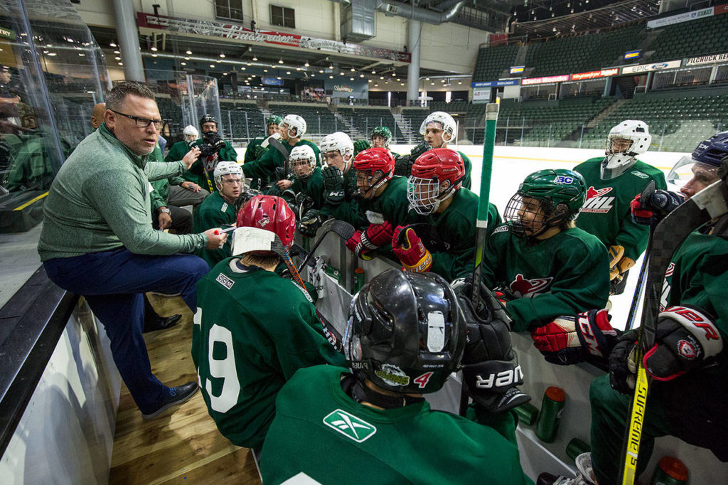 Silvertips coach Dave Williams talks with players during a break on the first day of training camp on Aug. 23, 2018, at Angel of the Winds Arena in Everett. (Andy Bronson / The Herald)