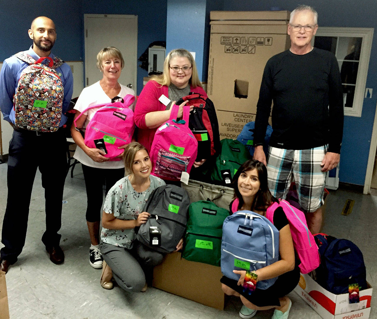 Volunteers on Aug. 21 packed 135 backpacks with school supplies for the YWCA School Days program. From left: Yusuf Hansia, Jane Tocco, Katie Thurston, Kristie Gilchrist, Yvonne De La Rosa and Gary Walderman. (Contributed photo)