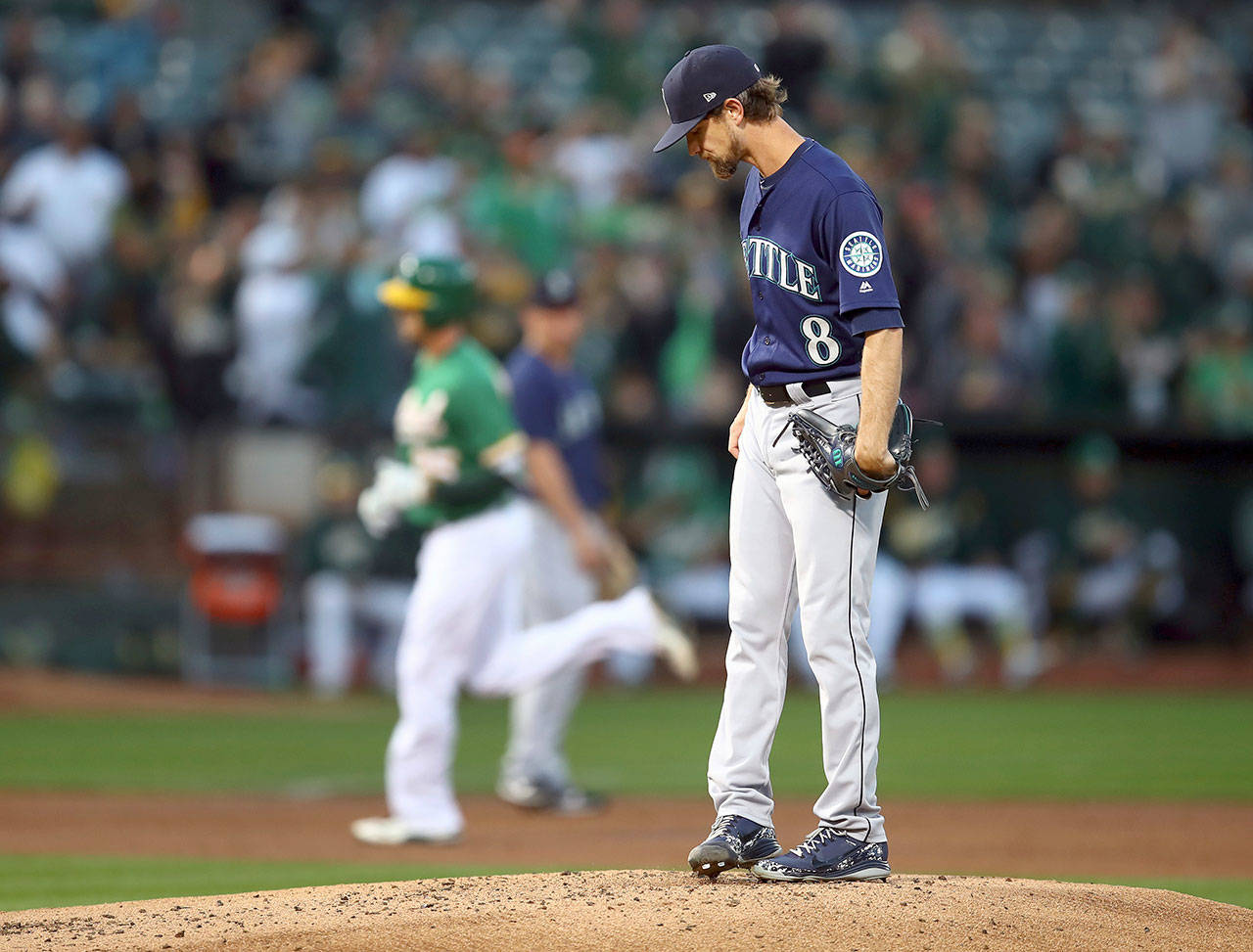Seattle's Mike Leake (8) stands on the mound while Oakland's Stephen Piscotty rounds the bases after hitting a two-run home run in the first inning of the Athletics' 7-5 win over the Mariners on Friday in Oakland, California. (AP Photo/Ben Margot)