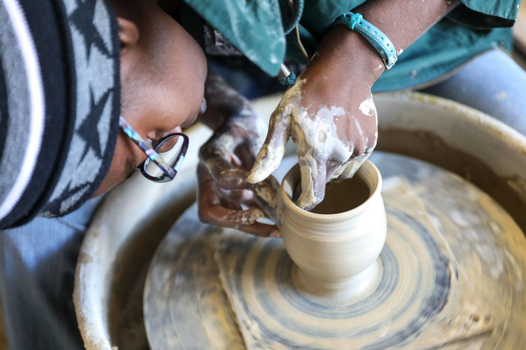 Akilah Spears, of Bruning Pottery, shows off her skills at the Makers Market hosted by the Evergreen State Fair. (Lizz Giordano / The Herald)