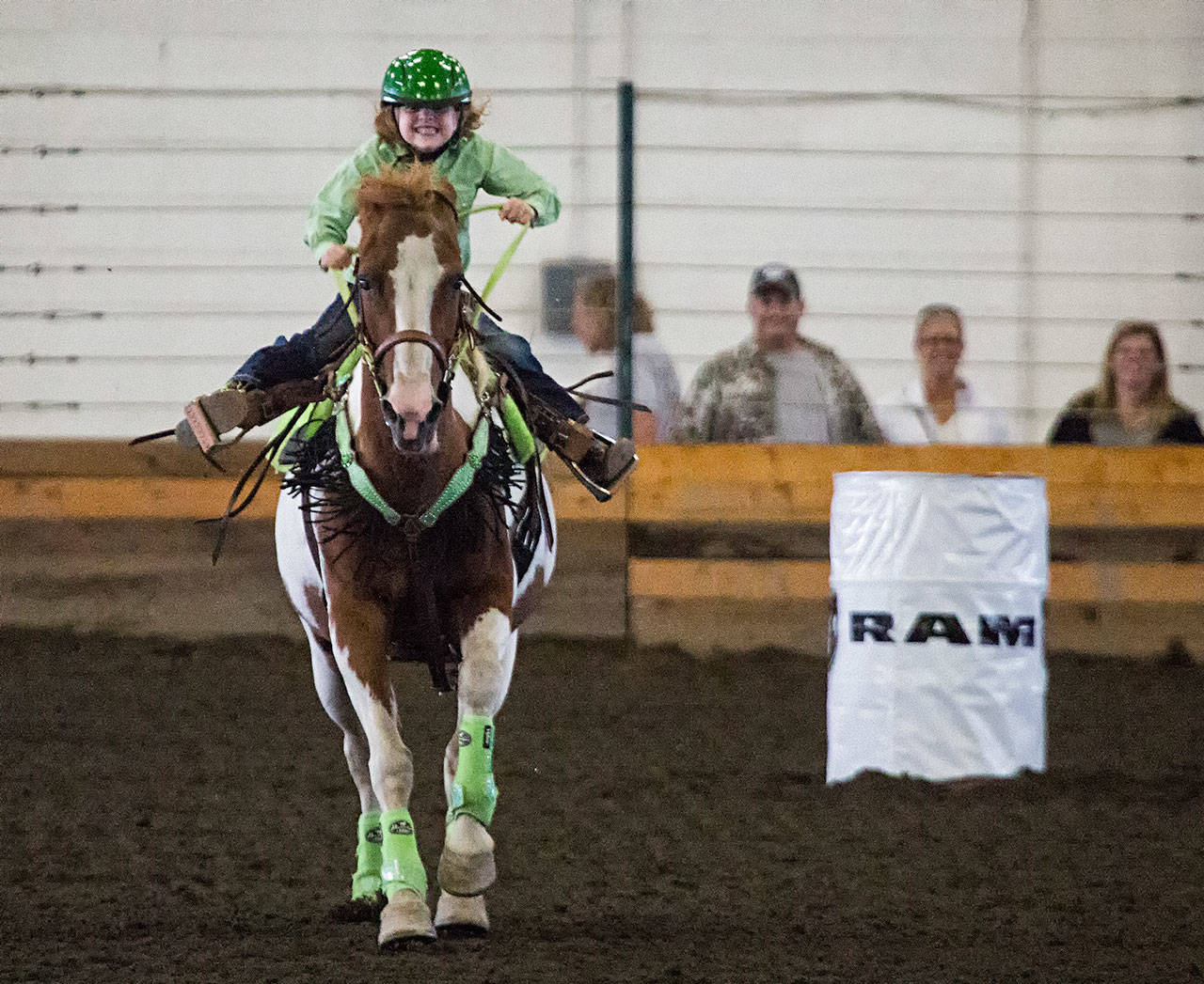 Teagan Petersen, 6, spurs her horse on to the finish line during barrel racing on the last day of Evergreen State Fair on Monday in Monroe. (Andy Bronson / The Herald)                                  Teagan Petersen, 6, spurs her horse on to the finish line during barrel racing on the last day of Evergreen State Fair on Monday in Monroe. (Andy Bronson / The Herald)