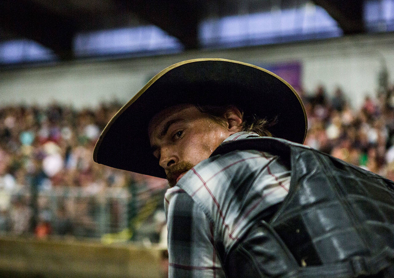 Wyatt Grant concentrates as he gets ready to ride during the Pro-West Rodeo at the Evergreen State Fair on Sept. 1, 2018 in Monroe, Wa. (Olivia Vanni / The Herald)