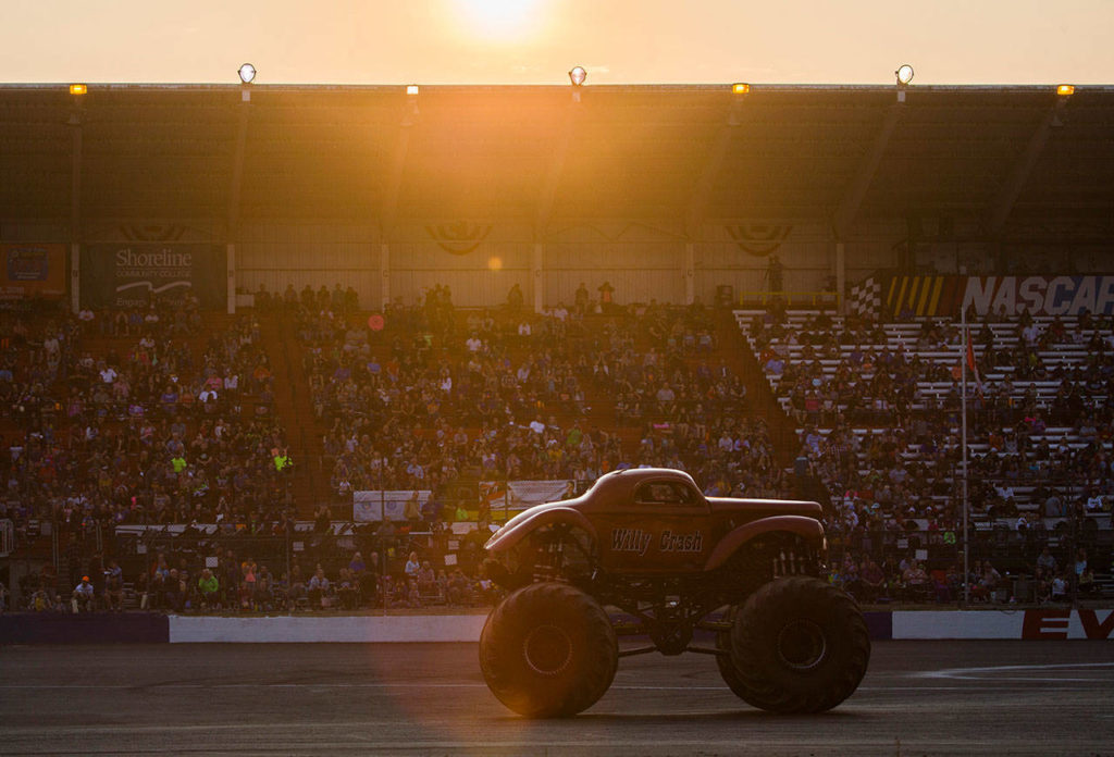 People fills the stands for Monster Trucks at the Evergreen State Fair on Aug. 24, 2018 in Monroe, Wa. (Olivia Vanni / The Herald)