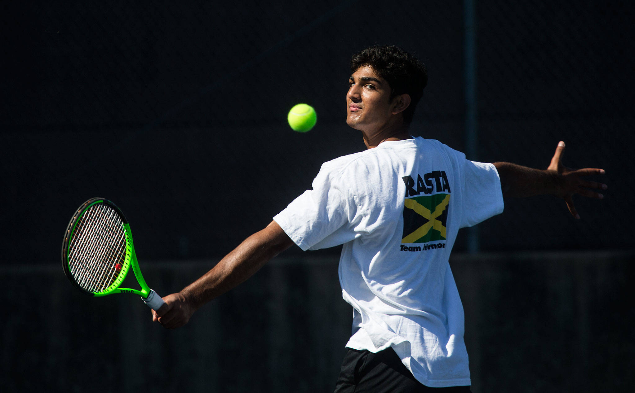 Jackson senior Anuj Vimawala watches the ball on a backhand shot during practice on Aug. 27 in Everett. Vimawala is one of the top returning tennis players in the area this season. (Andy Bronson / The Herald)