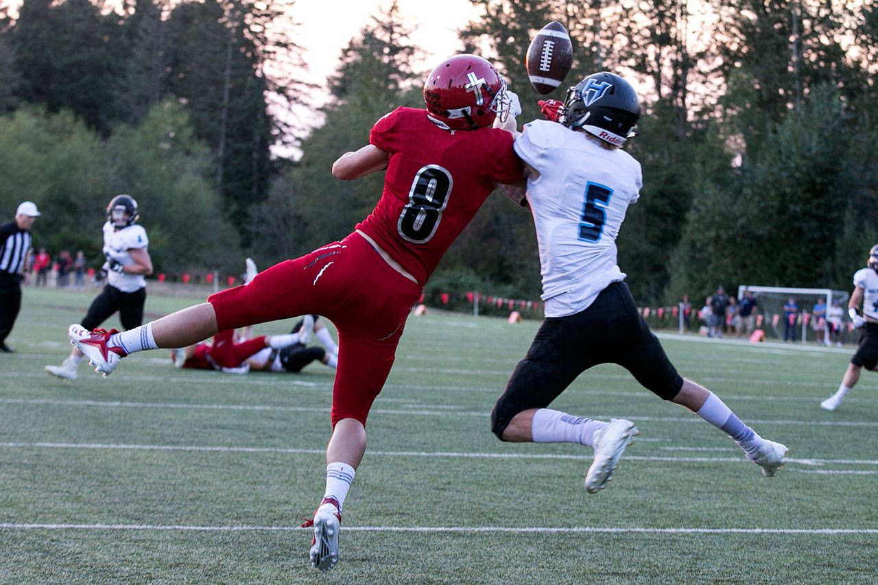 Hockinson's Wyatt Jones (right) breaks up a pass intended for Archbishop Murphy's Josh McCarron during a game on Sept. 6, 2018, at Archbishop Murphy High School in Everett. (Kevin Clark / The Herald)