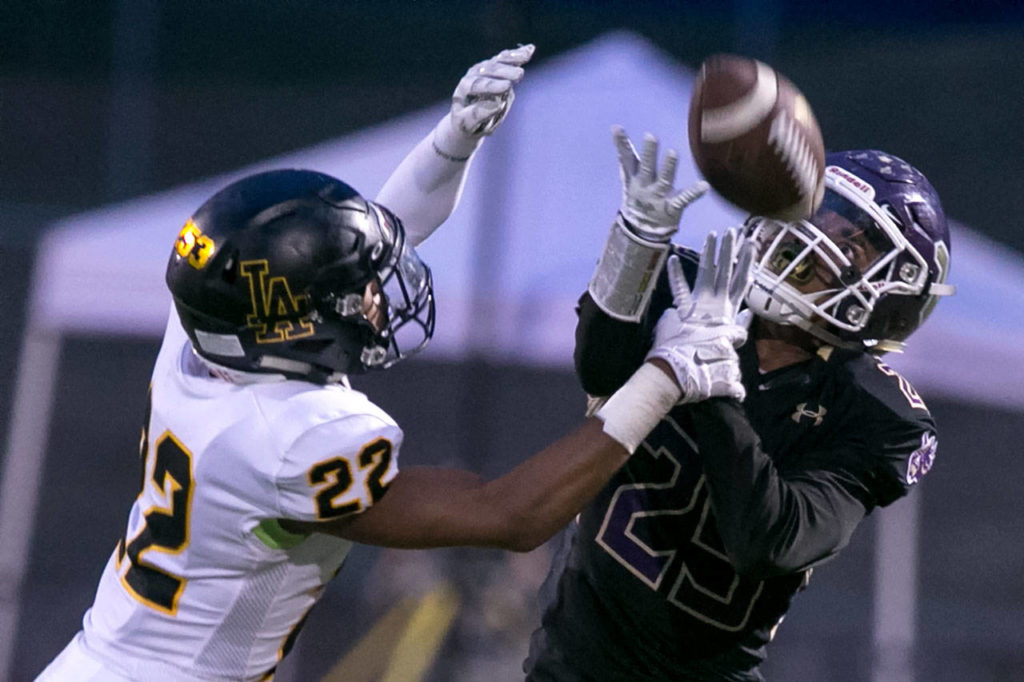 Lincoln's Khalil Rogers forces an incomplete pass attempt to Lake Stevens' Kasen Kinchen during a game on Sept. 7, 2018, at Lake Stevens High School. Lake Stevens win 38-21. (Kevin Clark / The Herald)