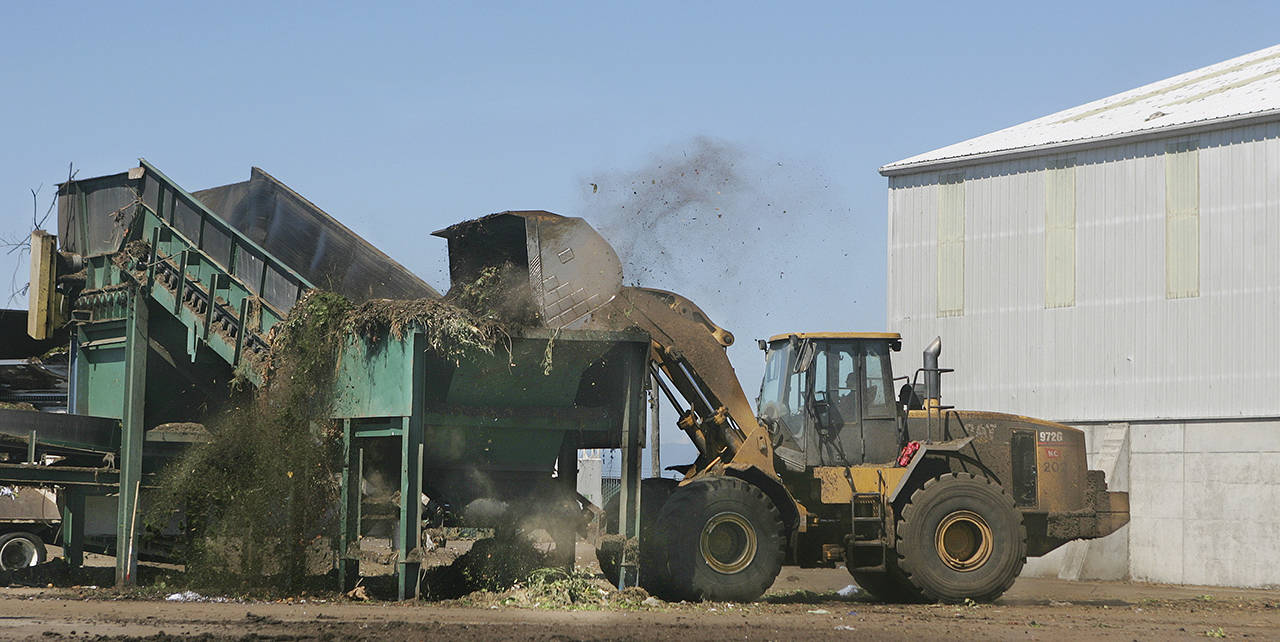 Compostable material is added to the digester at Cedar Grove Compost in 2008. (Mark Mulligan / Herald file)