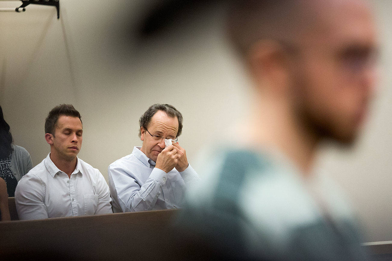 Alex, left, and Michael Konicke react as Zachary Konicke, who killed Michael's wife and tried to kill Michael, is sentenced at Snohomish County Courthouse on Thursday, Sept. 27, 2018 in Everett, Wa. On Thursday, Zachary Konicke was given the maximum allowable sentence of 23 years for murder in the second degree, assault in the second degree and arson. (Andy Bronson / The Herald)