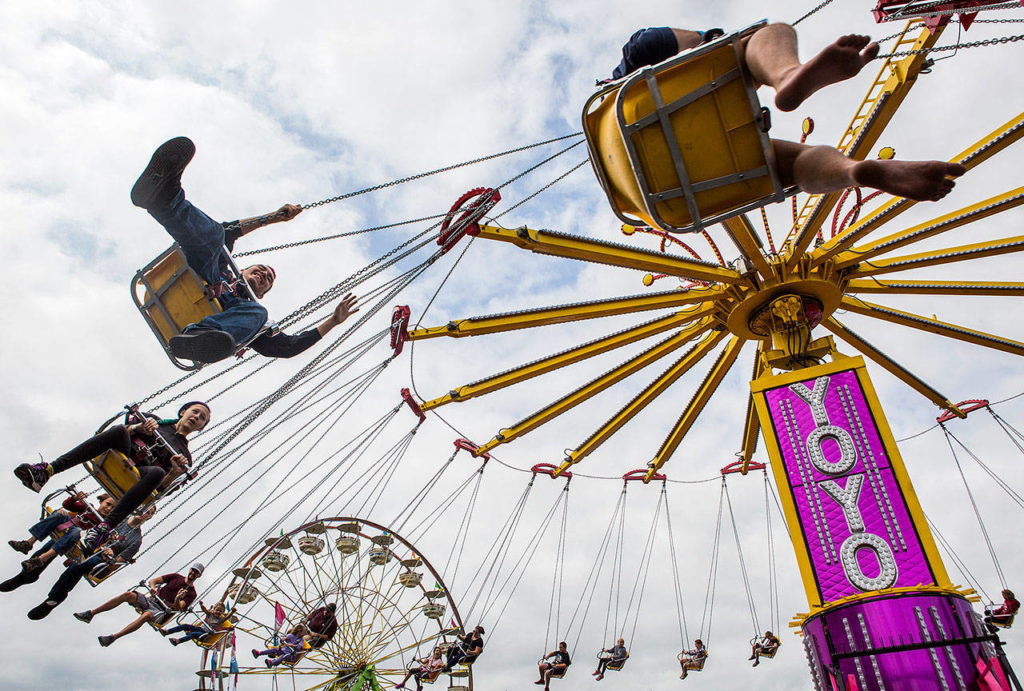People enjoy the Yoyo ride on opening day of the Evergreen State Fair in August. Over 350,000 people attended the Monroe-based fair, the largest of its kind in the Pacific Northwest. (Olivia Vanni / The Herald)