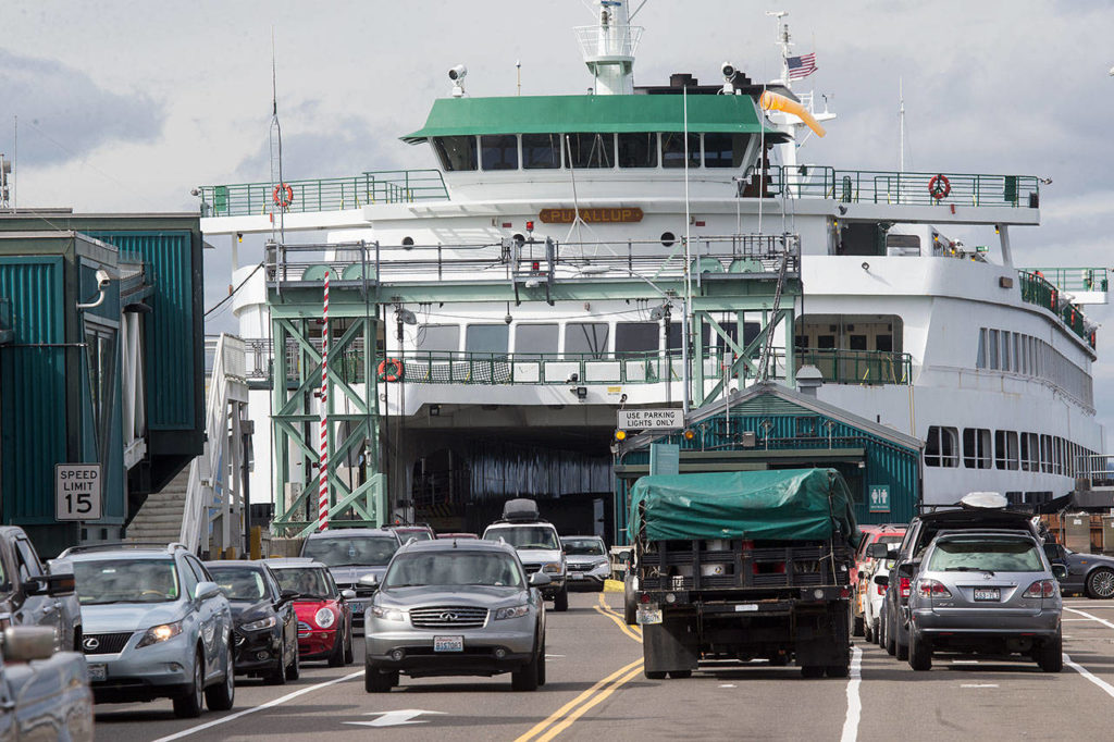 The MV Puyallup. a ferry capable of carrying 202 cars, offloads at the Edmonds Ferry dock on Friday, Sept. 21, 2018 in Edmonds, Wa. (Andy Bronson / The Herald)