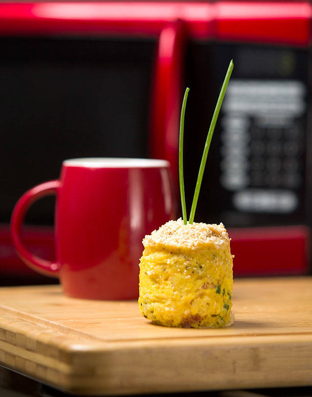 Coffee-cup quiche can be properly plated — or eaten straight from the mug it was cooked in. (Andy Bronson / The Herald)