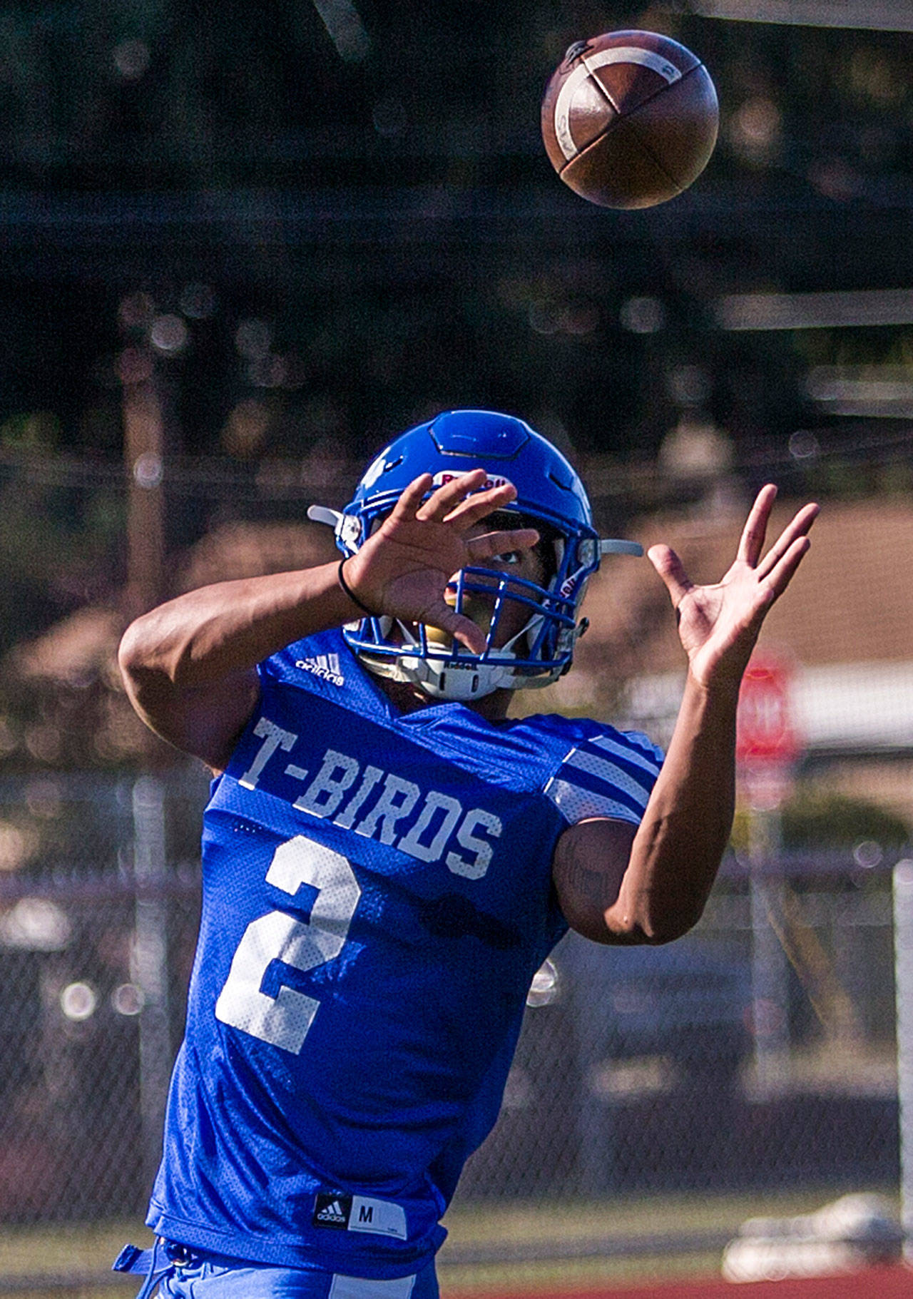 Shorewood receiver Jaro Rouse catches a pass during practice Wednesday afternoon at Shorewood High School in Shoreline. (Olivia Vanni / The Herald)