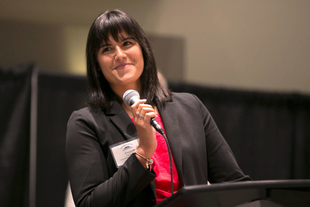 Former Lake Stevens and Boise State standout Brooke Pahukoa speaks to the crowdafter being honored as The Herald's 2017 Woman of the Year in Sports during the Snohomish County Sports Hall of Fame banquet on Sept. 19, 2018, at Angel of the Winds Arena in Everett. (Kevin Clark / The Herald)