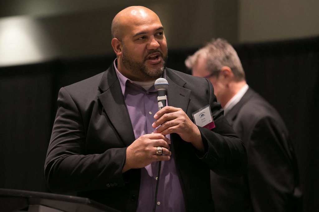Former Lake Stevens and University of Washington standout Richie Chambers speaks to the crowd after being inducted in the Snohomish County Sports Hall of Fame at a banquet on Sept. 19, 2018, at Angel of the Winds Arena in Everett. (Kevin Clark / The Herald)
