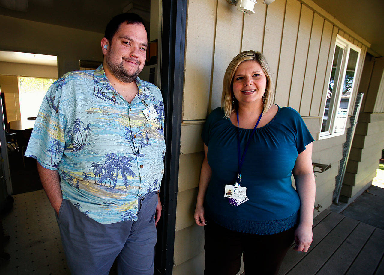 Ginger Merkel (right), executive director of the Marysville district's special education services, and fomer student Preston Dwoskin share some common goals now that Dwoskin has been hired to help guide current 18-21 program students toward work opportunities. (Dan Bates / The Herald)