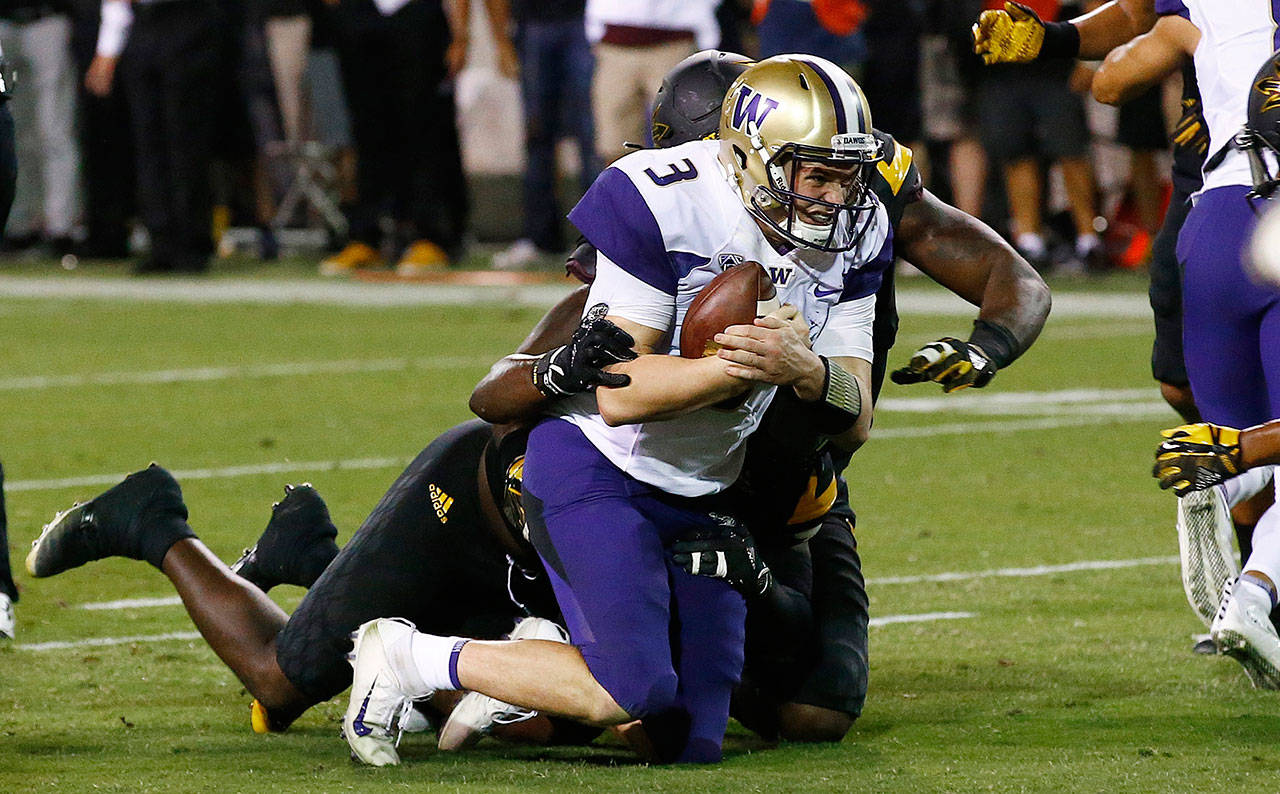 Washington quarterback Jake Browning (3) is tackled by the Arizona State defense short of the end zone during the second half of a game Oct. 14, 2017, in Tempe, Ariz. Arizona State defeated Washington 13-7. (AP Photo/Ross D. Franklin)