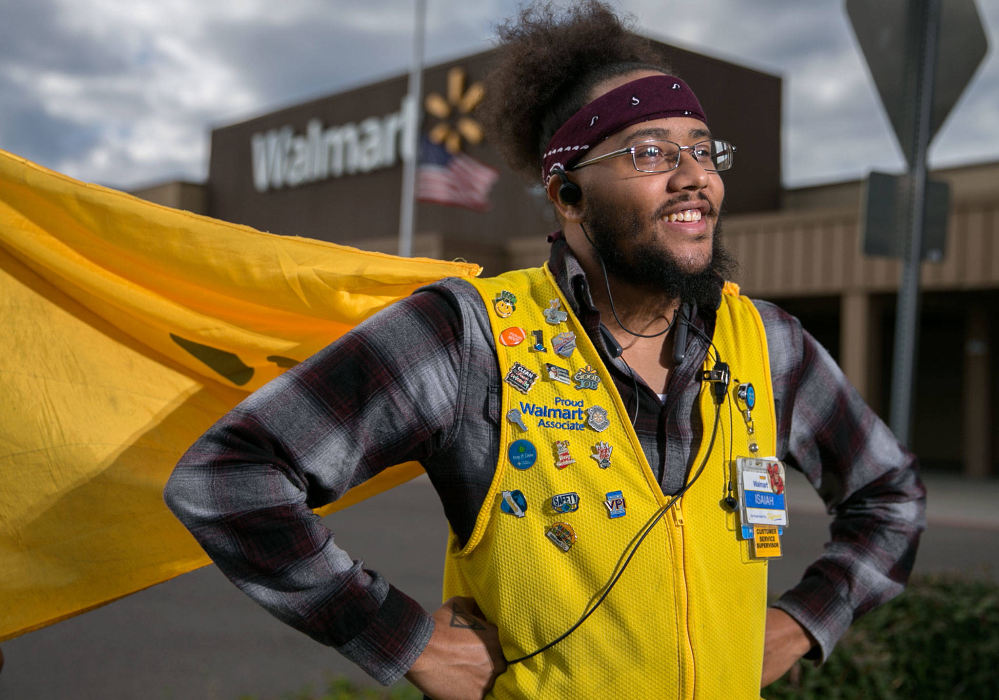 Isaiah Owens, a 4-year employee of Walmart, volunteered to wear a cape as part of the back-to-school season and continued the accessory after the promotion was over. (Kevin Clark / The Herald)