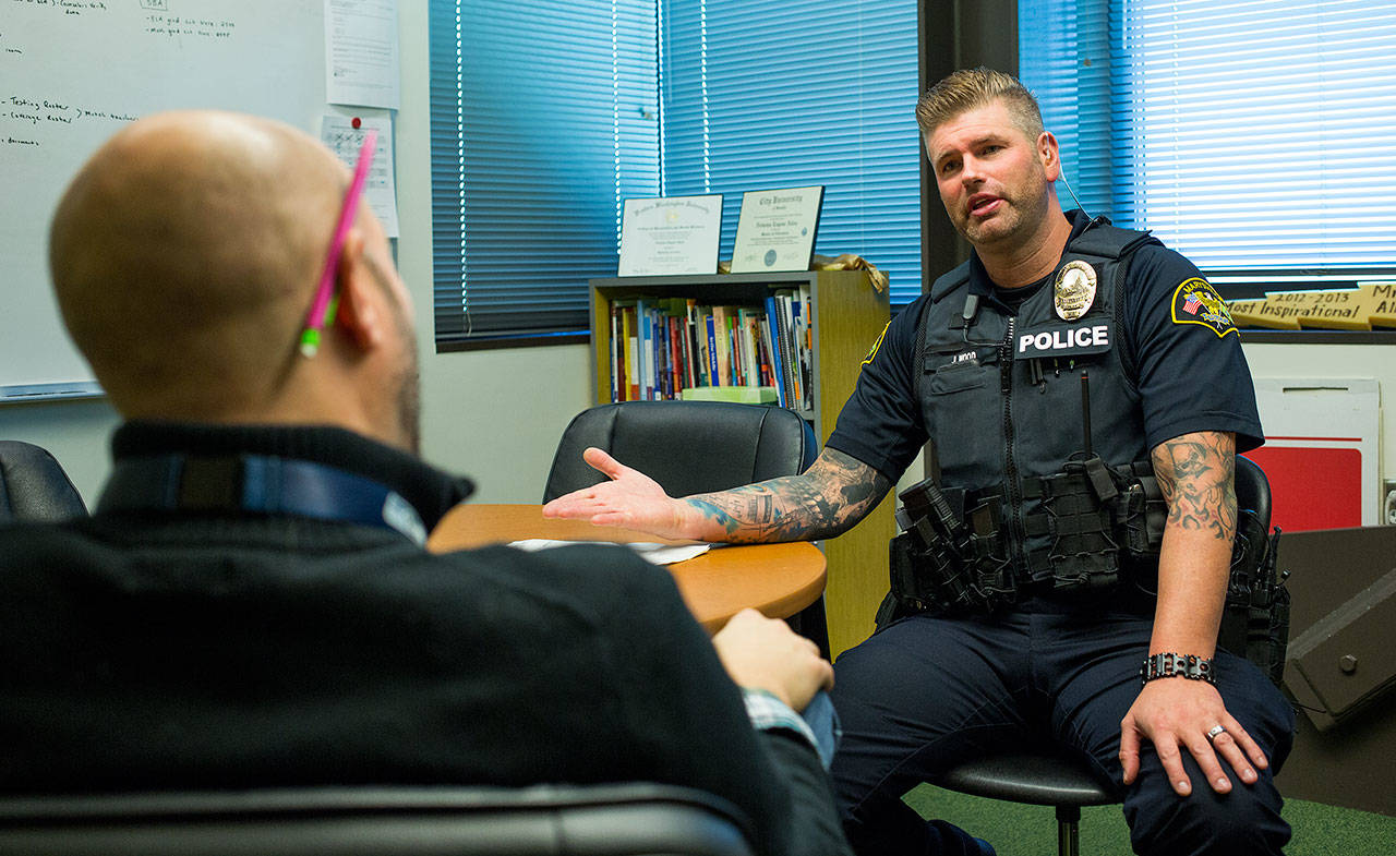 544e57cee1 School Resource Officer Jeremy Wood talks with Assistant Principal Nicholas  Allen about a trespassing situation with