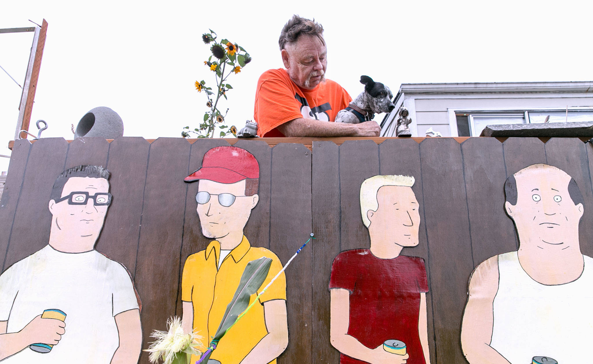"Kelly Hatley, 63, proudly displays characters from ""King of the Hill"" in his front yard in Freeland on Whidbey Island. An artist friend, Linda Frasier, painted the cutouts that are copied from the cartoon series. (Kevin Clark / The Herald)"