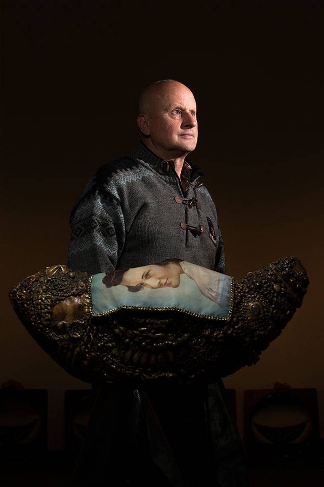 """Artist Steve Jensen with his mother's shroud over her boat in his exhibit """"Voyager"""" at the Schack Art Center in Everett. """"Voyager,"""" is on display through Nov. 3. (Andy Bronson / The Herald)"""
