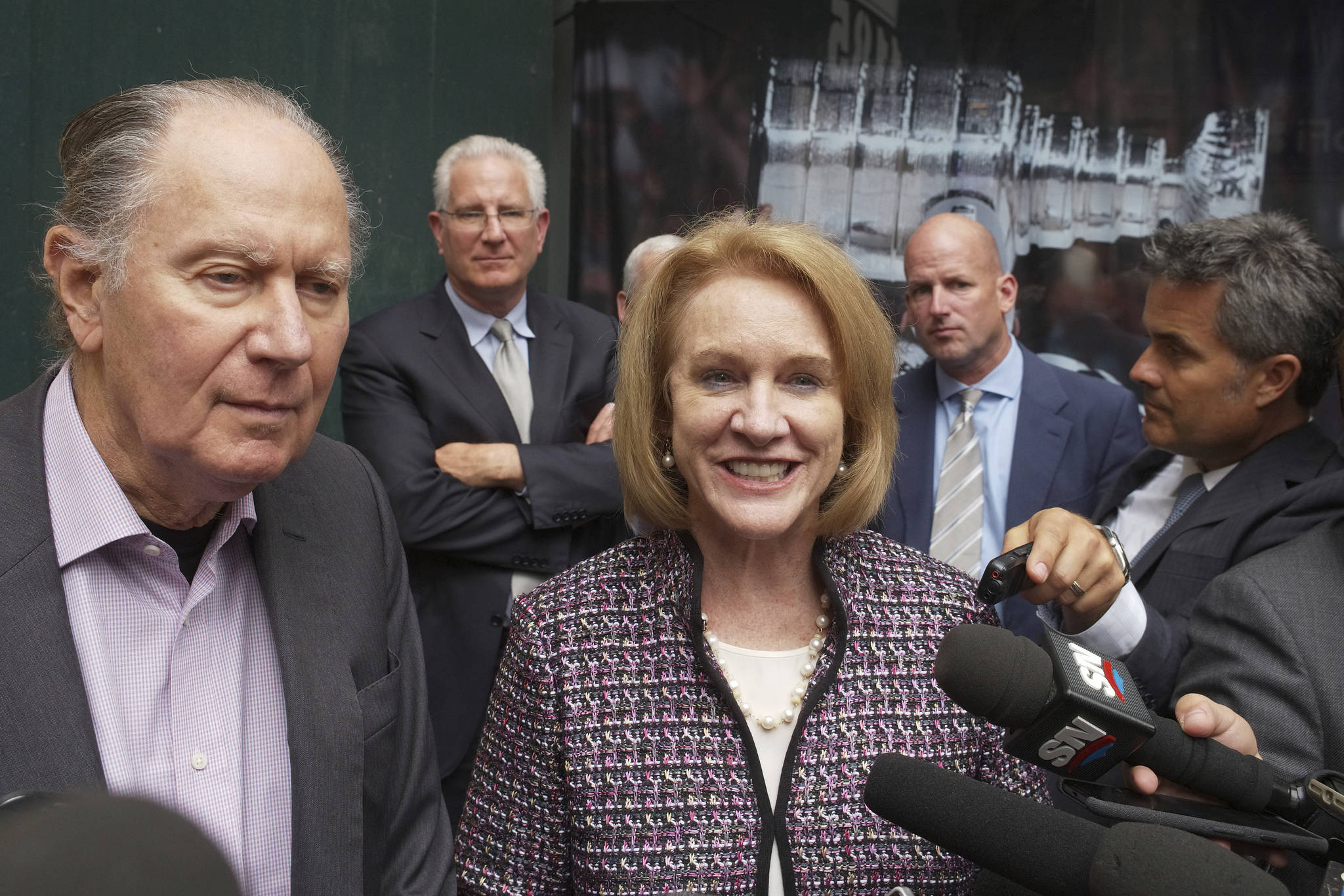 David Bonderman (left) and Seattle Mayor Jenny Durkan talk to the media as they leave a meeting at NHL headquarters Tuesday in New York. (AP Photo/Mark Lennihan)