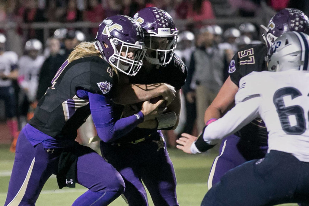 Lake Stevens' Tre Long (left) and Jackson Grafe cross the goal line. Grafe was credited with the touchdown on the play. (Kevin Clark / The Herald)