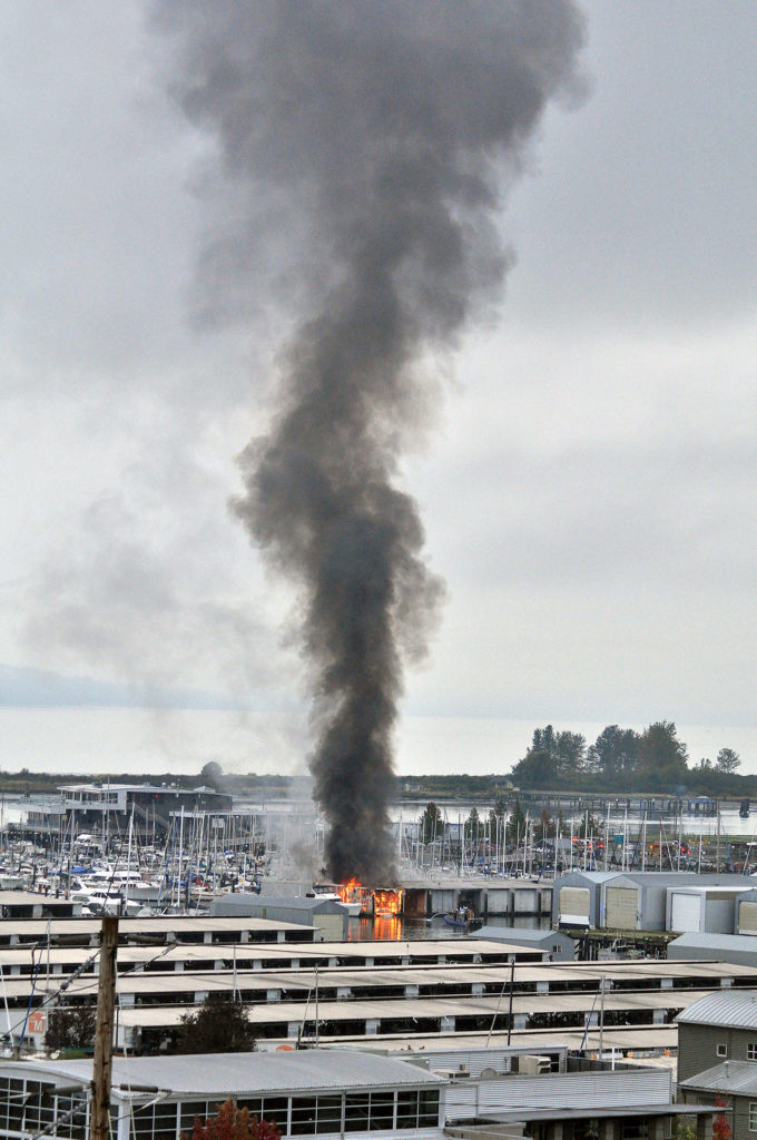A column of smoke from a boathouse fire on the Everett waterfront could be seen for miles on Monday. (Sue Misao / The Herald)
