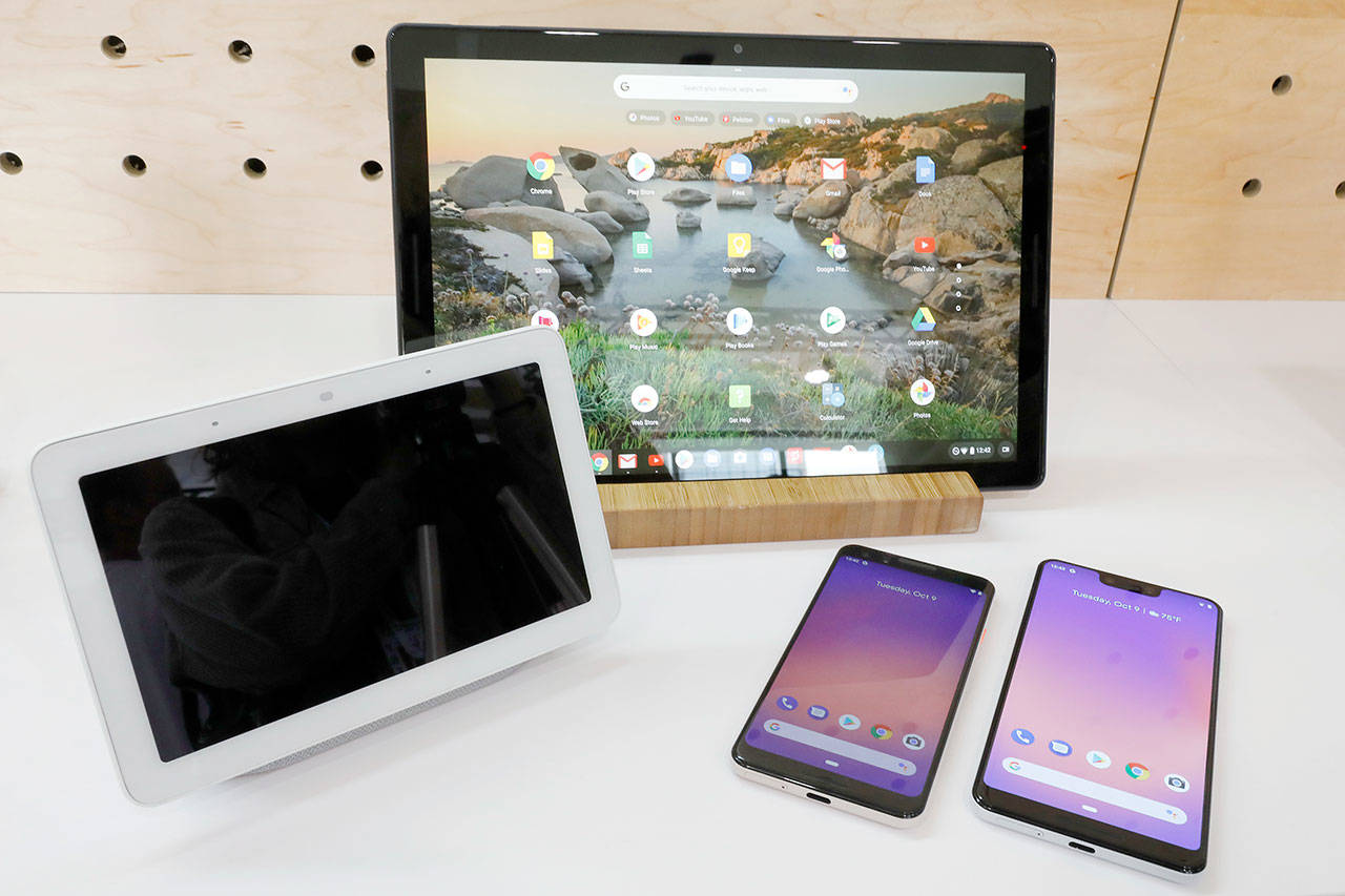 Google's new devices — from left, the Google Home Hub, the Pixel Slate and two new smartphones — were rolled out Tuesday. (Associated Press)