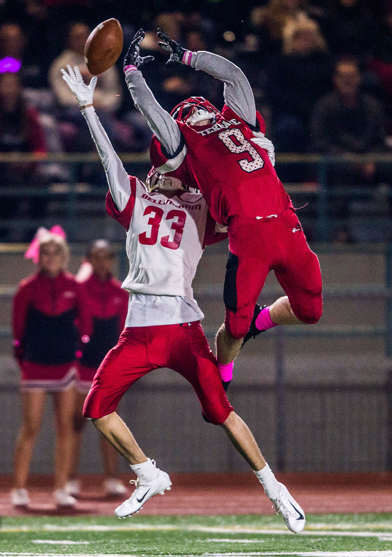 Mountlake Terrace's Brandon Bach (right) battles Bellingham's Trey Clayton for a pass during the game on Oct. 12, 2018, in Edmonds. (Olivia Vanni / The Herald)