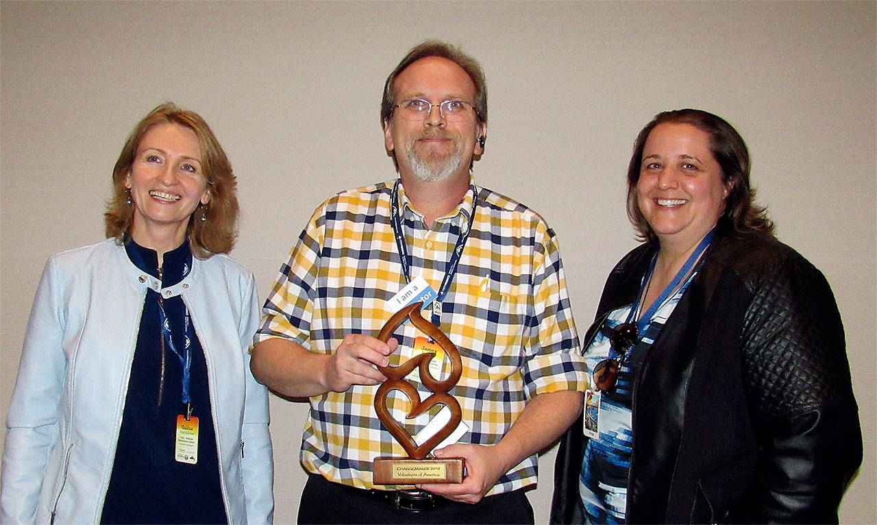 Volunteers of America Western Washington Dispute Resolution Center employees (from left) Galina Volchkova, housing program manager; James Rankin, fair housing counselor and trainer; and LaDessa Croucher, senior director of the dispute resolution program were honored with a ChangeMaker award for their work on landlord-tenant issues. (Contributed photo)
