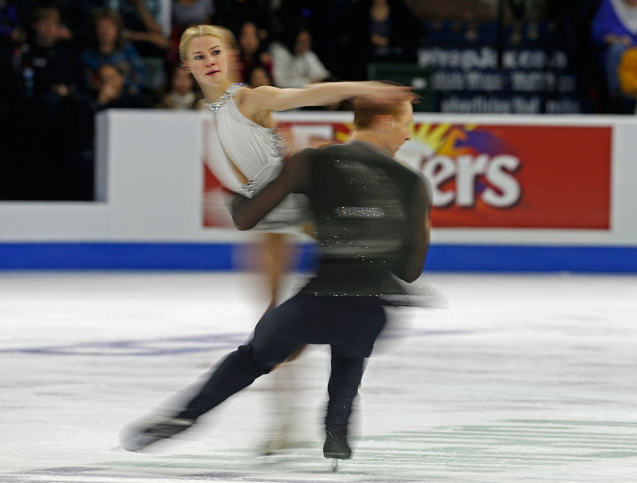 Evgenia Tarasova and Vladimir Morozov perform during the pair's free skating program at Skate America, Friday, Oct. 19, 2018, in Everett, Wash. (Olivia Vanni / The Herald)
