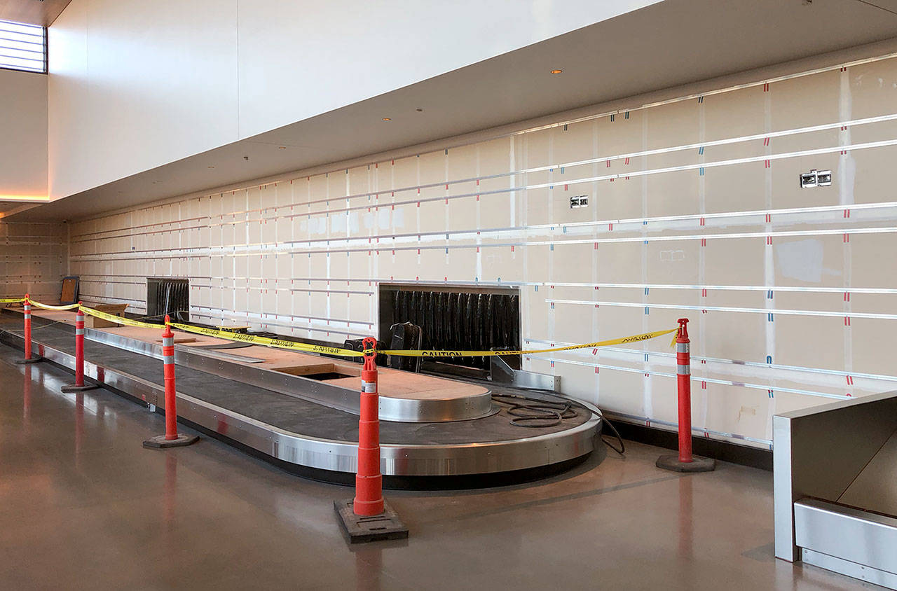 The baggage-claim carousel earlier this month at the nearly completed passenger terminal at Paine Field in Everett. (Janice Podsada / The Herald)