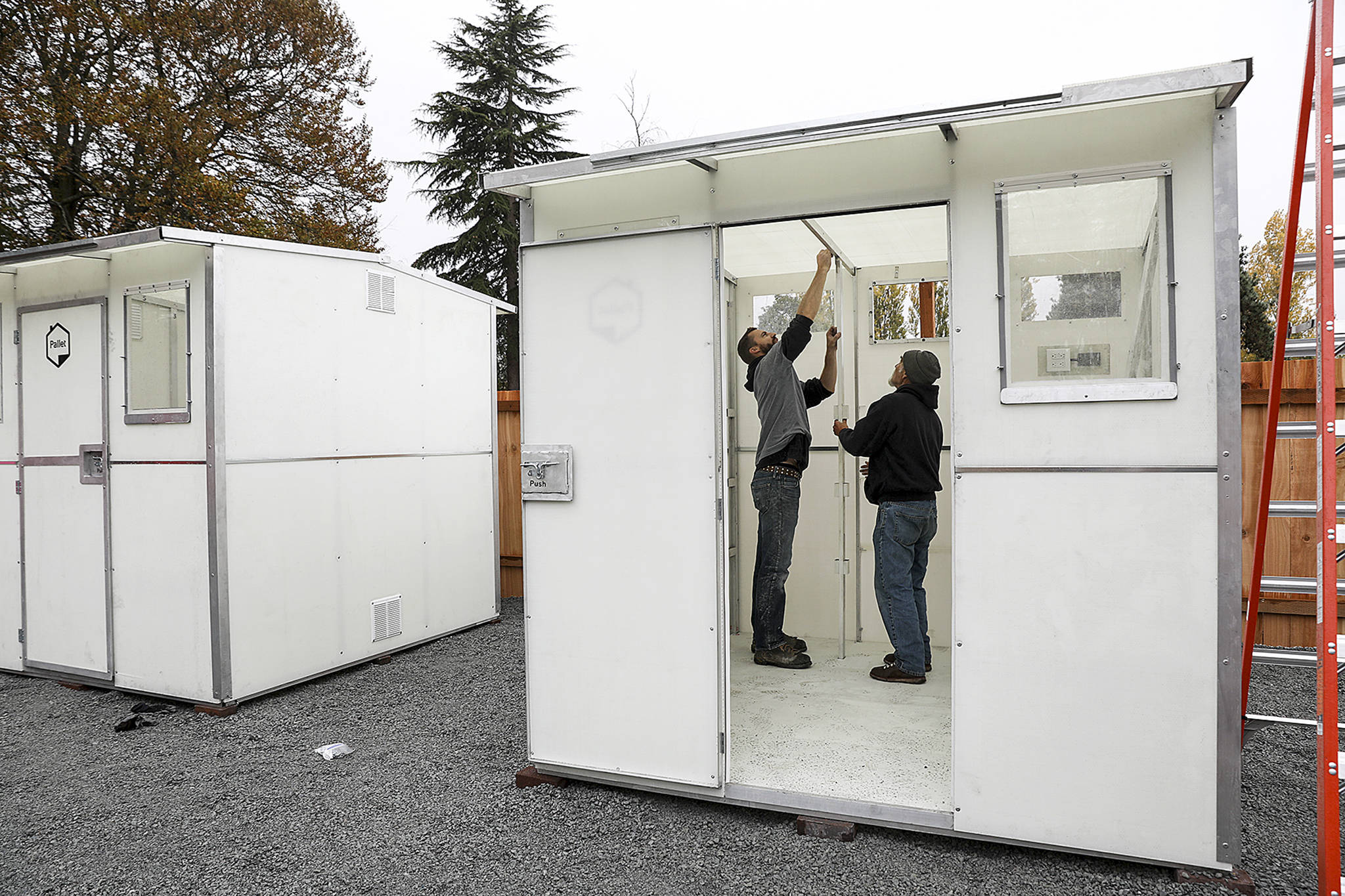 "Six tiny homes <a href=""https://www.heraldnet.com/news/first-authorized-tiny-home-village-opens-in-snohomish-county/"" target=""_blank"">were installed</a> on the grounds of Good Shepherd Baptist Church in Lynnwood on Oct. 25. (Lizz Giordano / The Herald)"