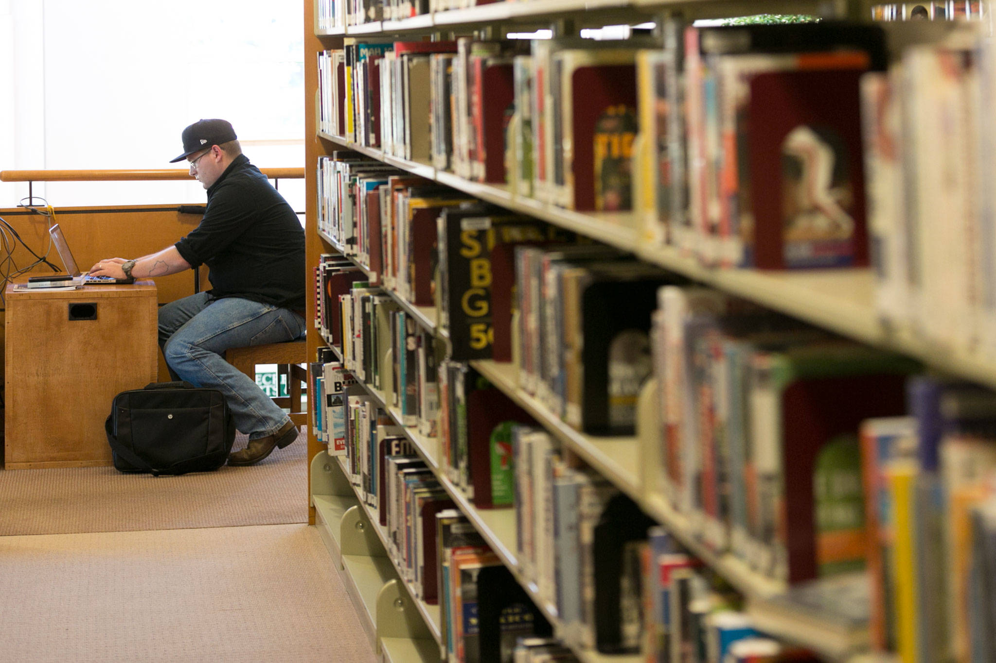 Eric Lancaster of Everett is participating in National Novel Writing Month in November. (Kevin Clark / The Herald)