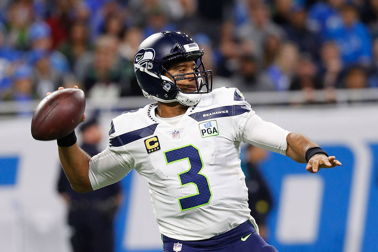Wilson throws three TD passes in Seahawks' victory over Lions
