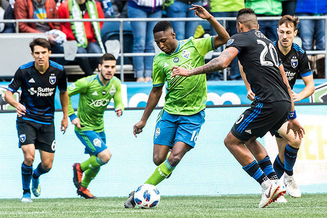 Seattle Sounders defender Kelvin Leerdam (center) maneuvers around San Jose Earthquakes midfielder Anibal Godoy in the first half of an MLS soccer game Sunday in Seattle. (Bettina Hansen/The Seattle Times via AP)