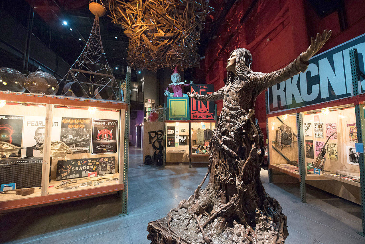 """The """"Pearl Jam: Home and Away"""" exhibit at the Museum of Pop Culture is on display through early 2019. A central piece of the exhibit is a new statue of the late Andrew Wood. Wood helmed the pre-Pearl Jam band, Mother Love Bone. (Jim Bennett/MoPOP)"""
