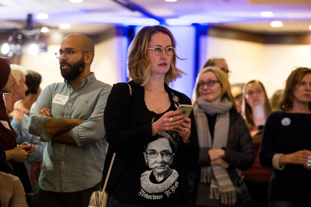 Laura Taylor sports a Notorious RBG shirt as she watches the election returns at the Washington State Democratic Party's 2018 Election Night Watch Party at the Bellevue Hilton on Tuesday. (Andy Bronson / The Herald) Laura Taylor watches the election returns at the Washington State Democratic Party's election night party at the Bellevue Hilton on Tuesday. (Andy Bronson / The Herald)