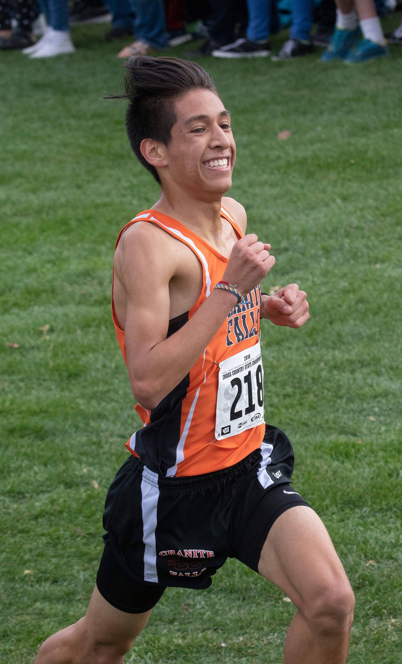 Granite Falls' Isaac Cortes runs in the 1A boys state cross country championship meet Saturday at Sun Willows Golf Course in Pasco. (TJ Mullinax / for The Herald)