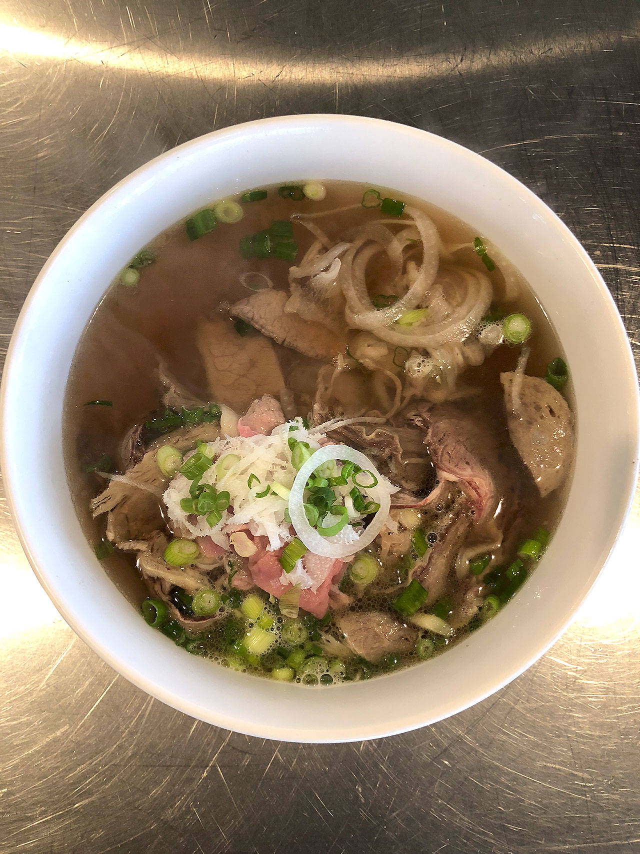 Basil's special meat-lovers pho, called dac biet, has steak, flank, brisket, tendon, tripe and Vietnamese beef balls. (Andrew Pham)