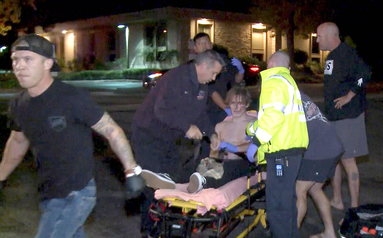 A victim is treated near the scene of a shooting Wednesday night in Thousand Oaks, California. (RMG News via AP)