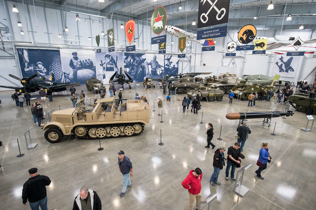 Visitors admire the tanks and planes in the new 30,000-square-foot hangar at the Flying Heritage & Combat Armor Museum at Paine Field on Saturday, Nov. 10, 2018 in Everett. (Andy Bronson / The Herald)