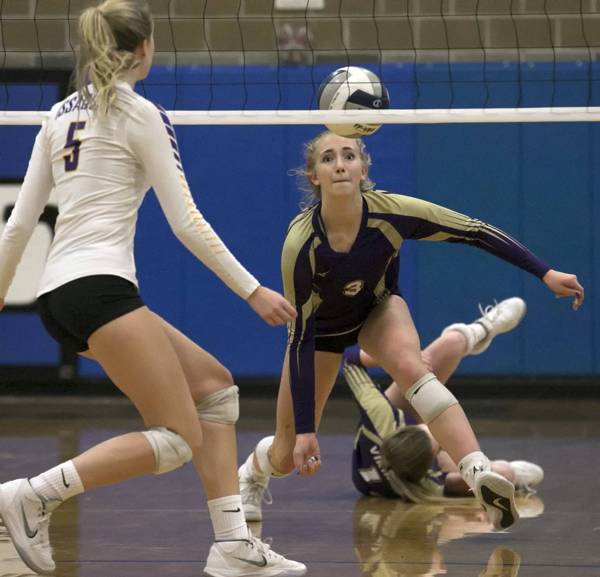 Lake Stevens' Samaya Morin attempts a dig with Issaquah's Zoe Hennings (left) looking on during the District Volleyball Tournament at Bothell High School on Nov. 6. Chargers won 25-17. (Kevin Clark / The Herald)