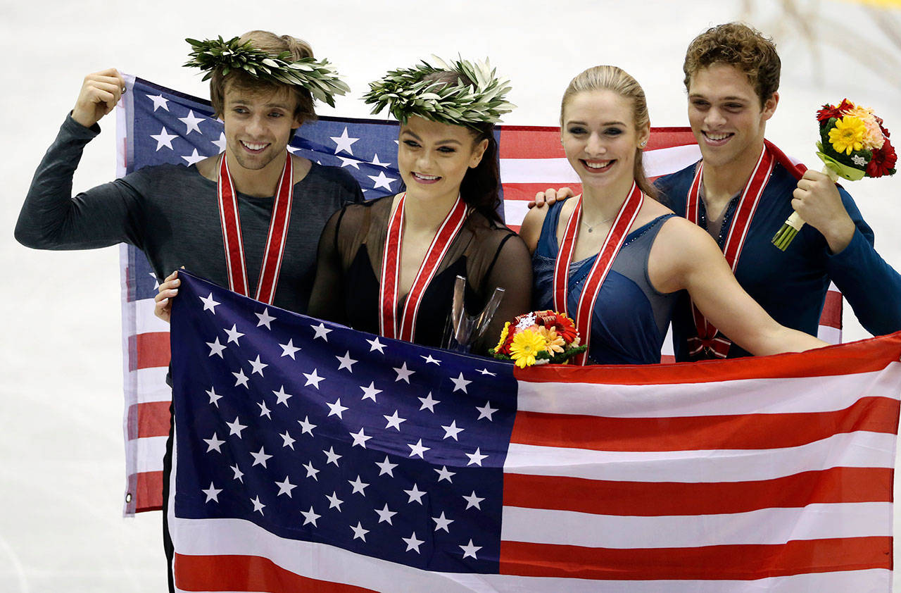 Koji Sasahara / Associated Press                                From left, gold medalists Jean Luc Baker and Kaitlin Hawayek of the United States pose for a photo along with bronze medalists Rachel Parsons and Michael Parsons of the United States during the award ceremony at the NHK Trophy figure skating ice dance event in Hiroshima, Japan.