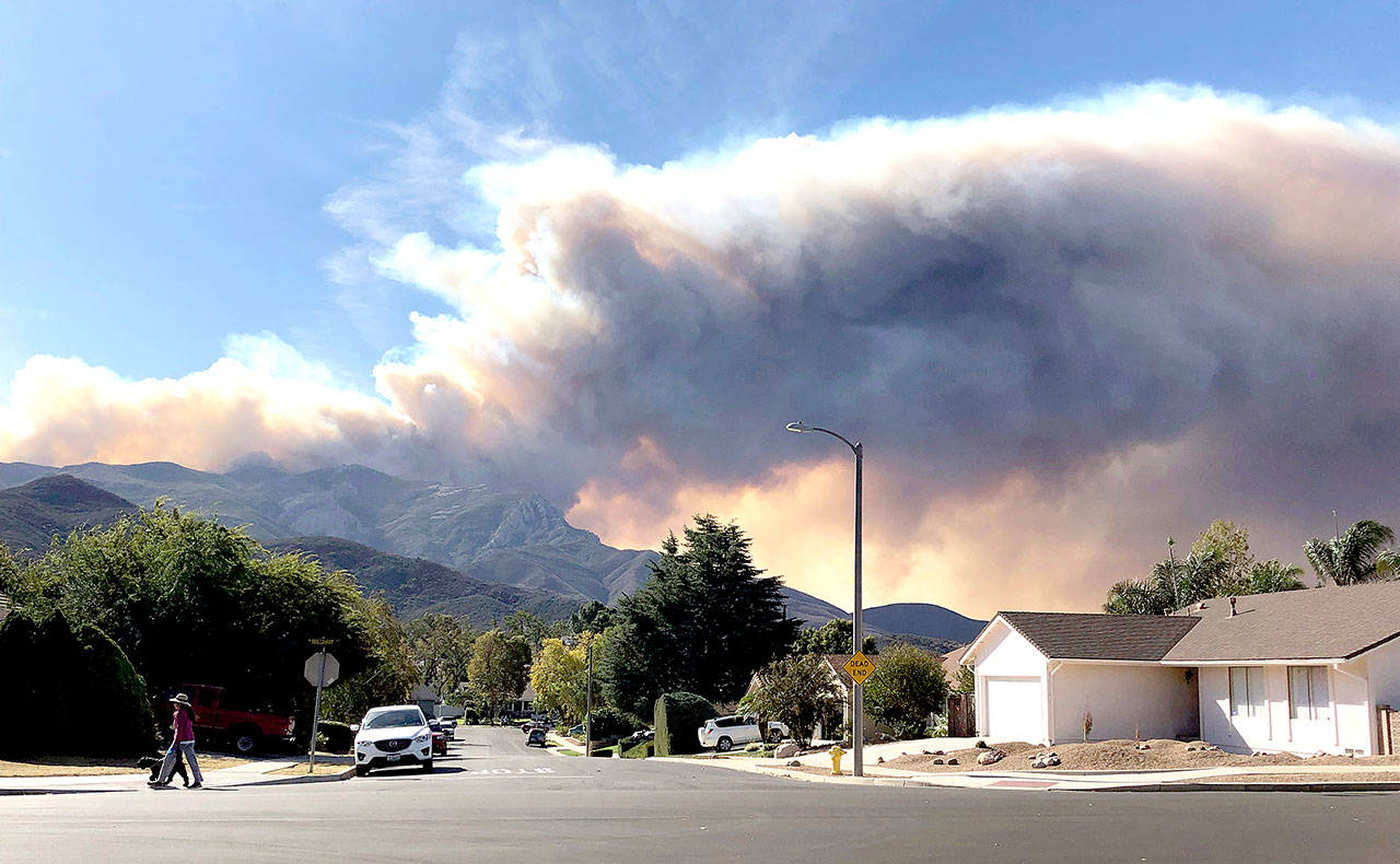 A large wildfire plume from a recent flareup near Lake Sherwood, California, is visible from Thousand Oaks on Tuesday. (Associated Press / Amanda Myers)