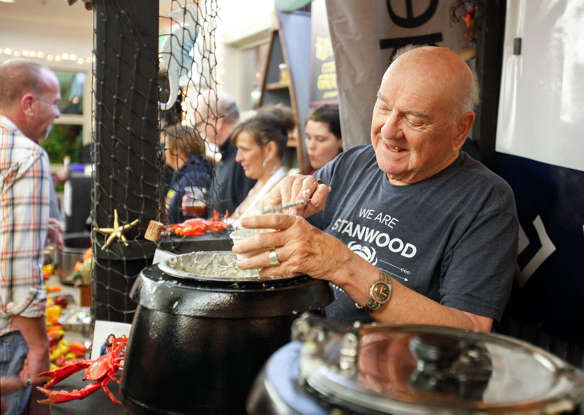 David Dannenberg serves chowder from the Windermere Real Estate Stanwood and Camano Island booth at the 23rd annual Chili Chowder Cook-Off. The event, held Nov. 10 at the Camano Center on Camano Island, drew a record 1,761 people to vote on chili and chowder made by 24 contestants. (Evan Thompson / The Herald)
